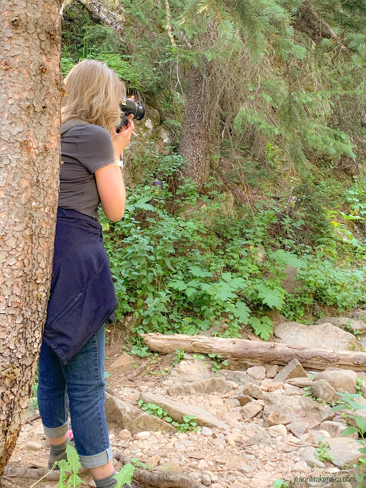 A woman taking a photo with a camera