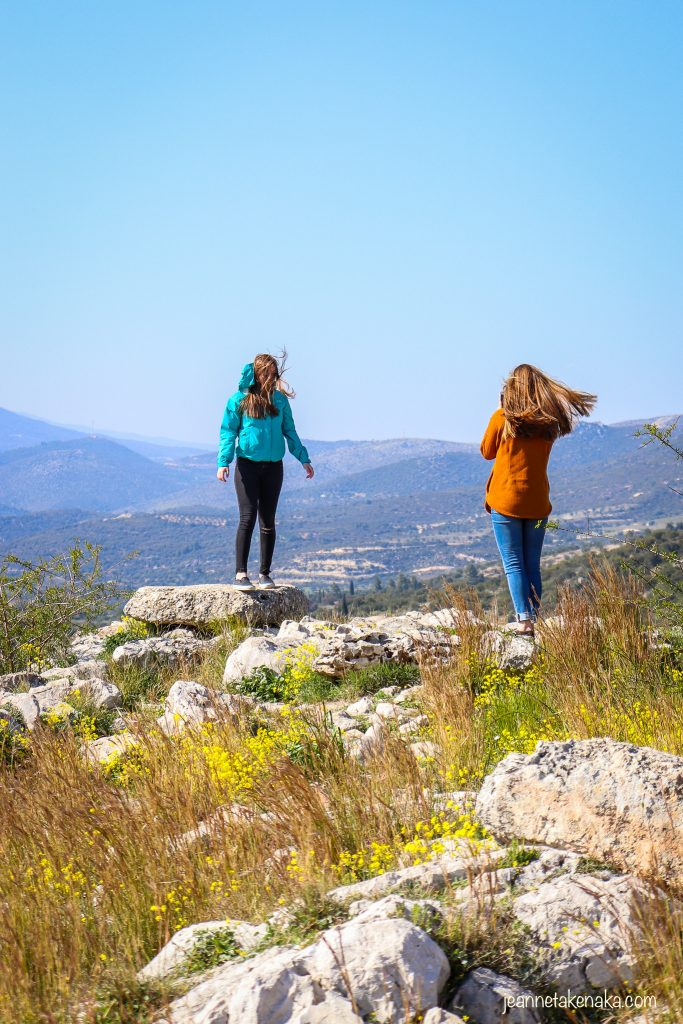Two teenaged girls taking photos of each other