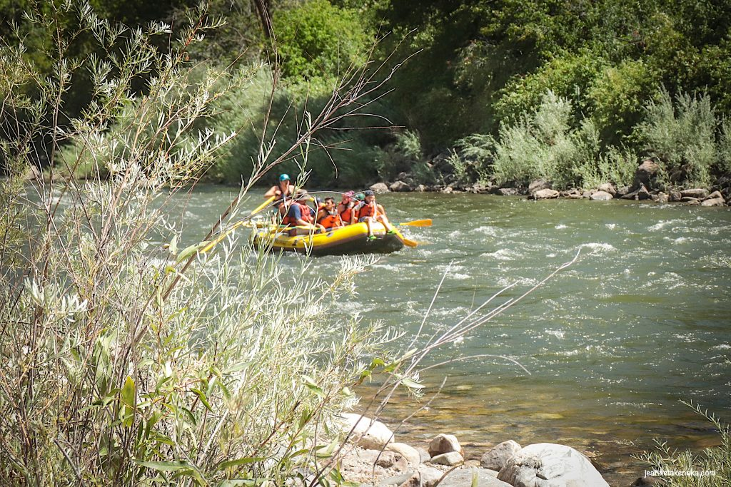 Fulfillment in relationships-a group of people rafting down the river