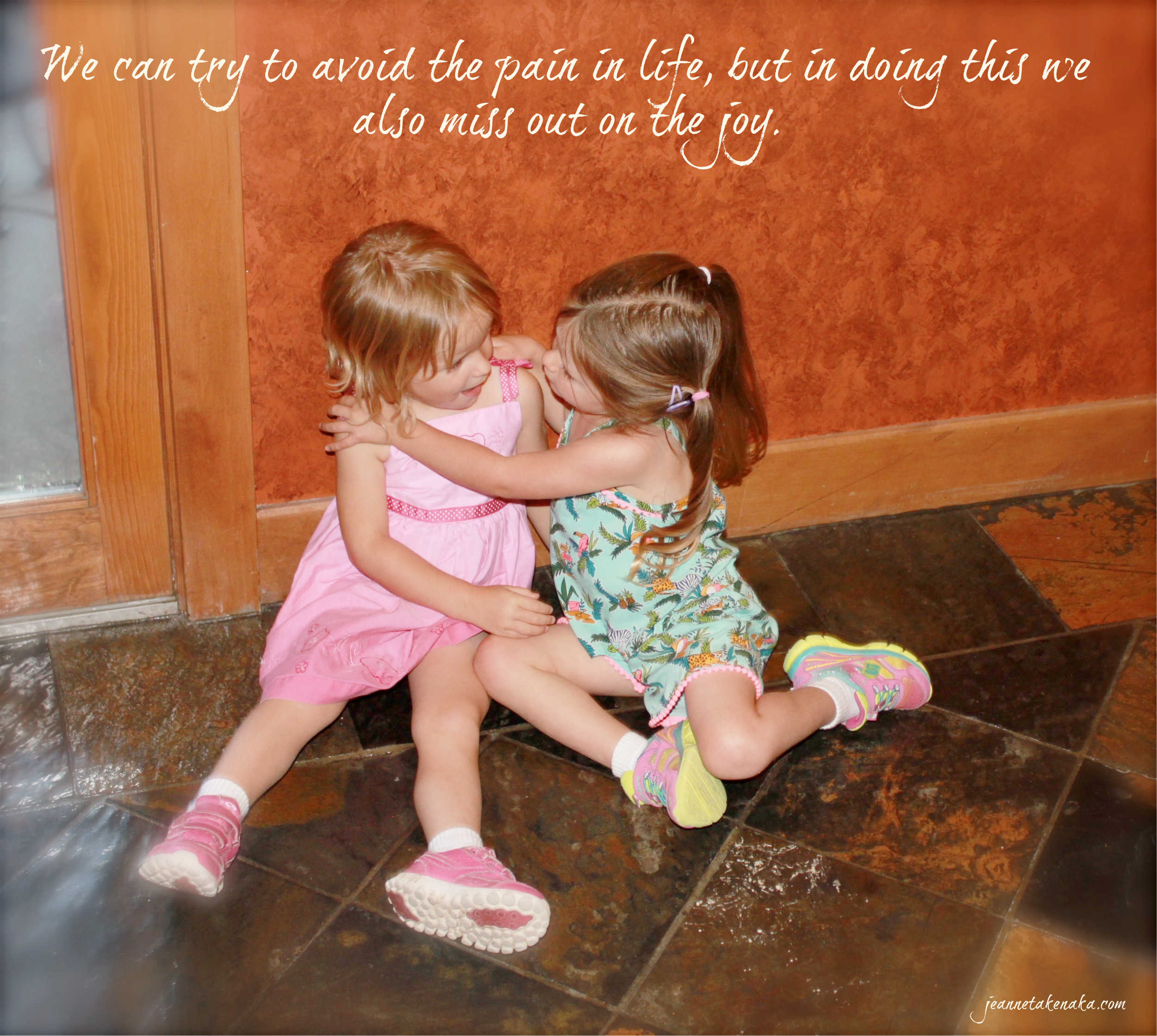"""Meme with the words, """"We can try to avoid the pain in life, but in doing this, we also miss out on the joy."""" on a backdrop of two small girls playing together"""