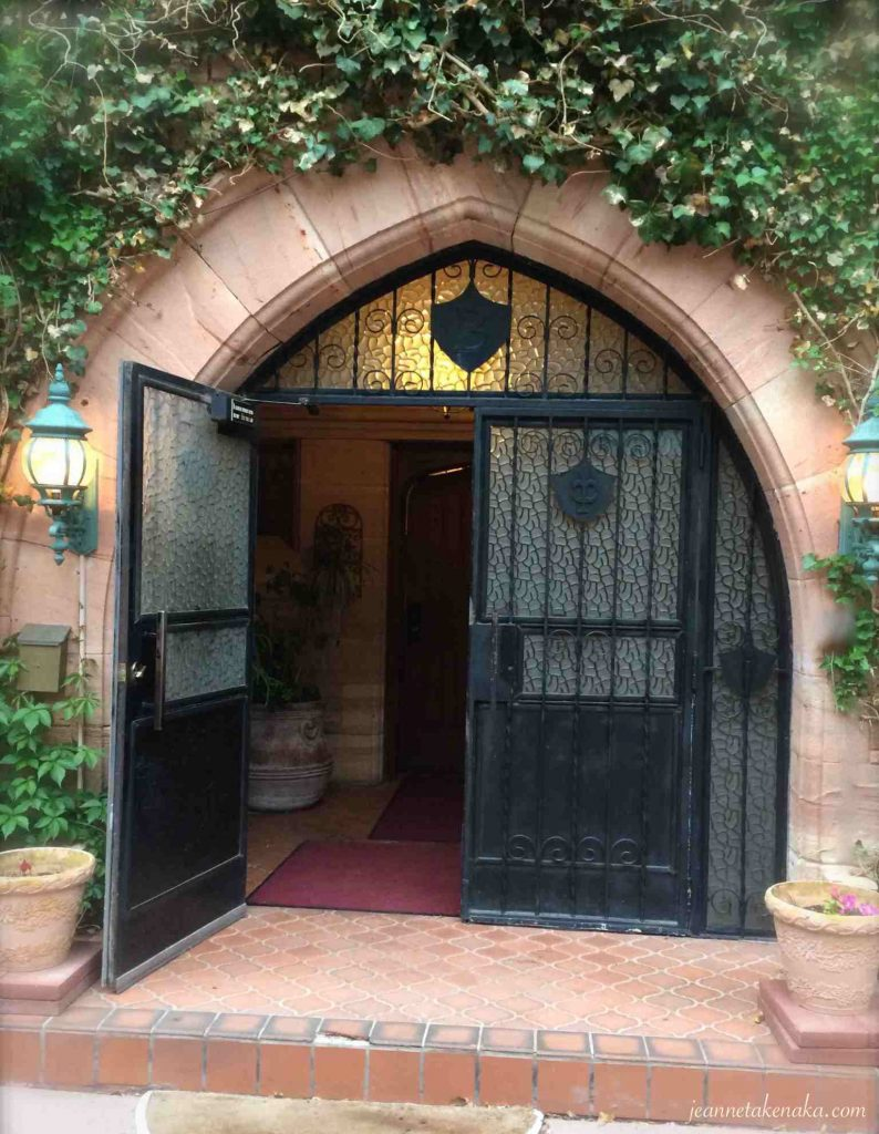 A set of two wrought-iron doors, one open in invitation to renew our hearts and minds