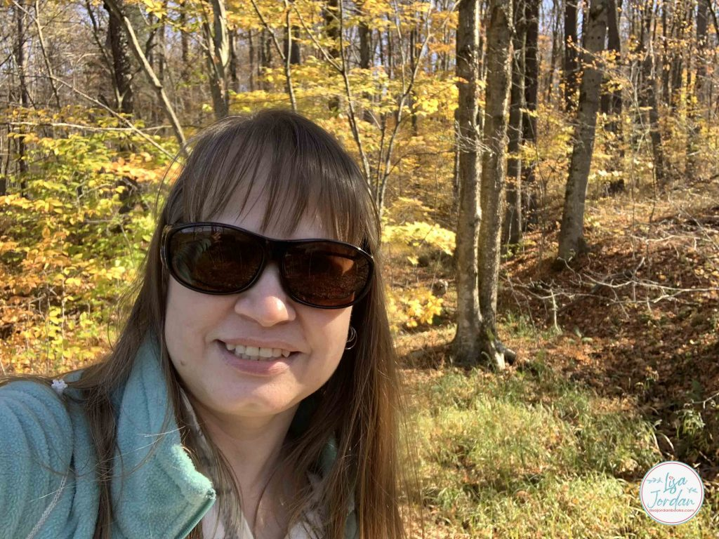 The author, Lisa Jordan, with a backdrop of yellow leaves