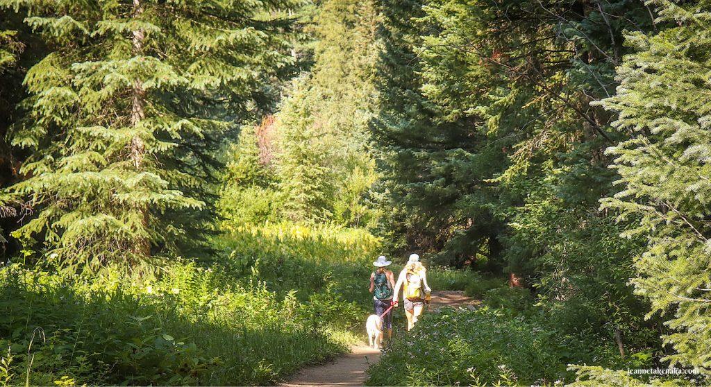 Two women walking a trail, creating community