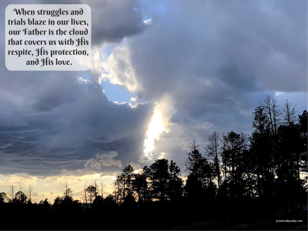 """A meme that says, """"When struggles and trials blaze in our lives, our Father is the cloud that covers us with His respite, His protection, and His love."""" on a backdrop of large clouds above a silhouette of trees"""