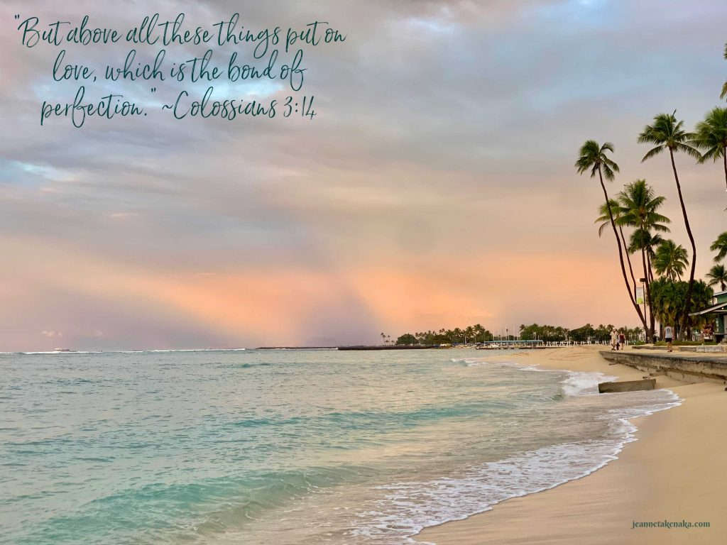 """Meme that says, """"But above all these things, put on love, which is the bond of perfection."""" on a backdrop of a sunrise sky over the ocean and beach"""