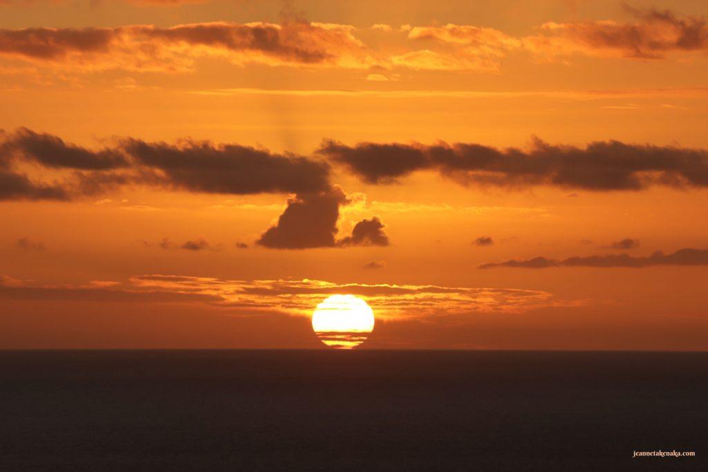 A deep orange sunset over the ocean