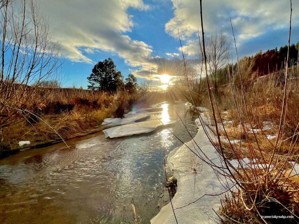 The sun peeking out of a cloud and reflecting on a snowy creek . . . reminder of how, even when life is hard, we can find beauty and refreshment
