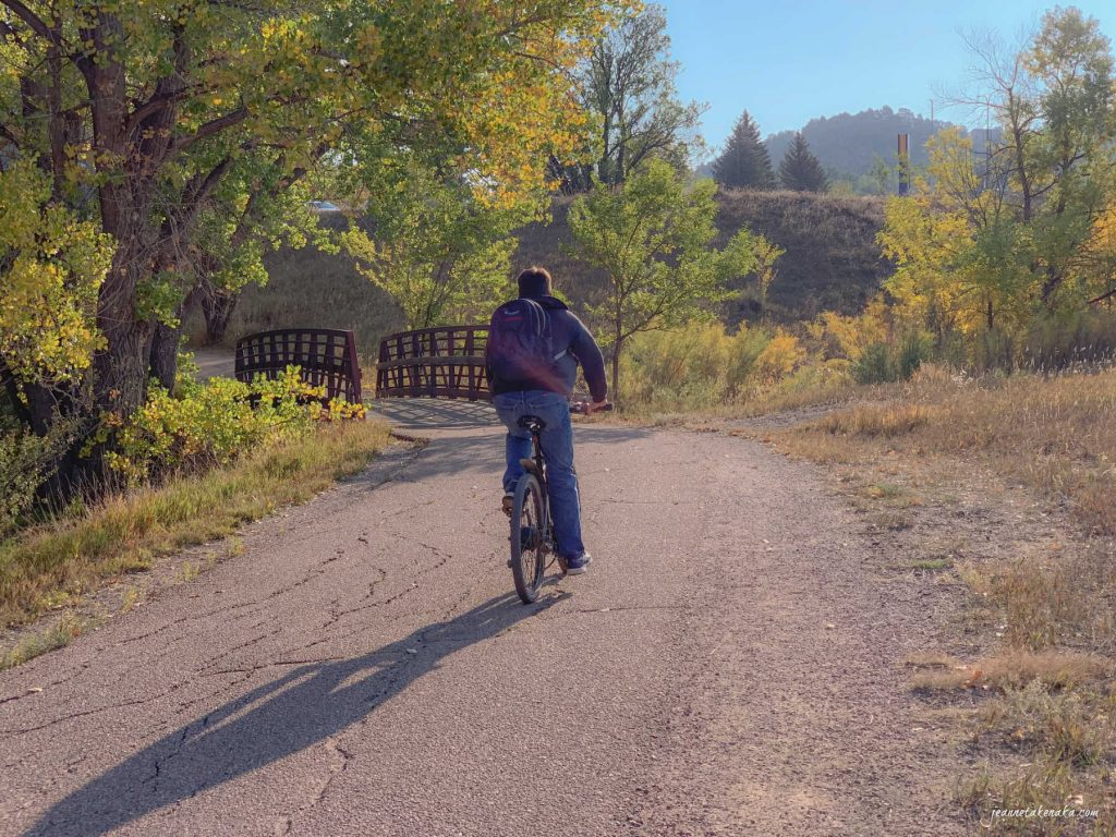 A cyclist on a trail, visual of what the author is discussing leading into waiting times and anticipating outcomes