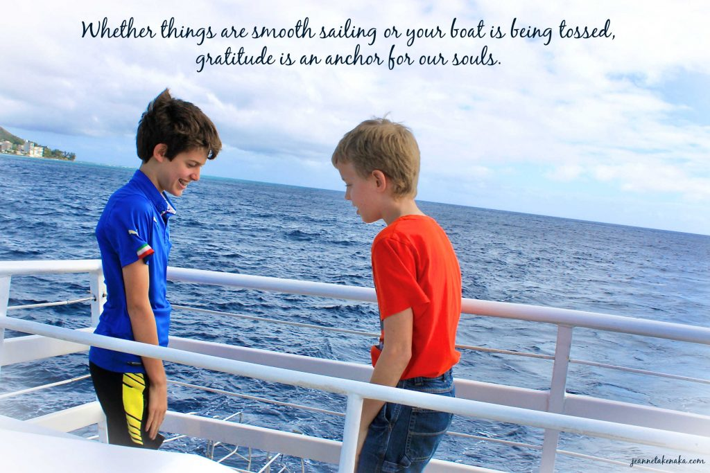"""A meme with the words, """"Whether things are smooth sailing or your boat is being tossed, gratitude is an anchor for our souls."""" on a backdrop of a photo of two teen boys on a boat with the ocean in the background"""