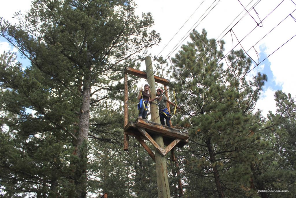 The author and a friend at a stopping point on a ropes course. We find courage by stepping out and doing the thing we're afraid of