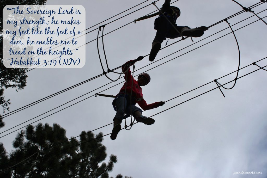 """Meme with the words, """"the Sovereign Lord is my strength; hem makes my feet like the feet of a deer, he enables me to tread on the heights."""" on a backdrop of two people silhouetted on a ropes course"""