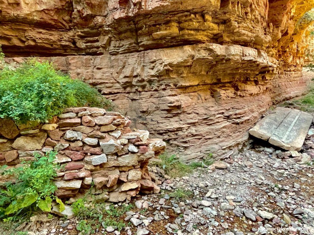A rock face wall behind a manmade rock wall . . . sometimes the rock walls in our lives tempt us to ask, Does God Care?